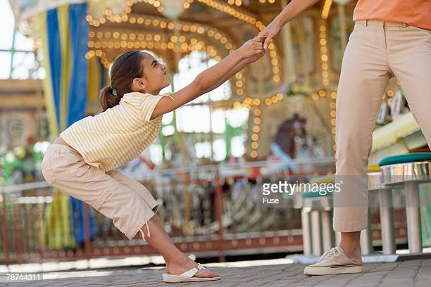 girl tugging on her mother's hand - dragging stock pictures, royalty-free photos & images