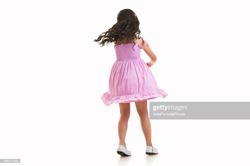 Girl twirling around : Stock Photo