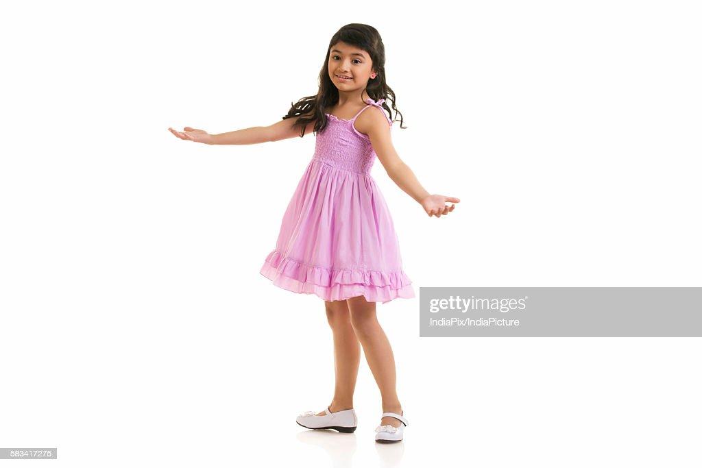 Girl twirling around : Stock Photo