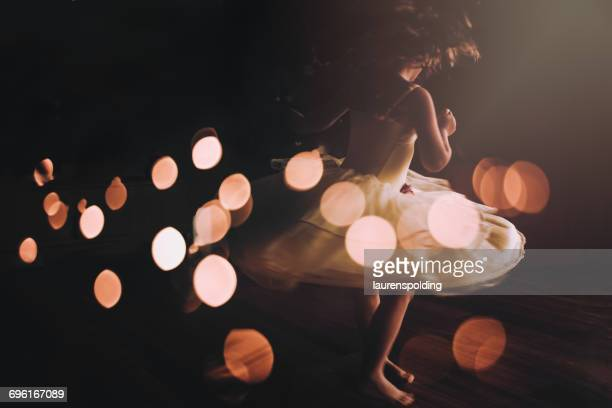 Girl twirling in party dress