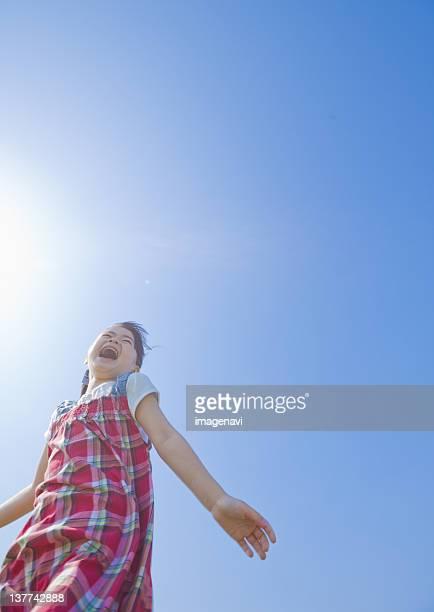 Girl under blue sky