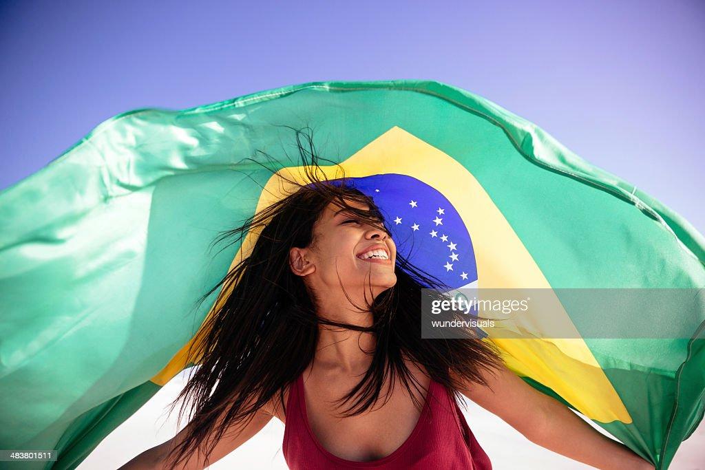 Girl under brazilian flag : Stock Photo