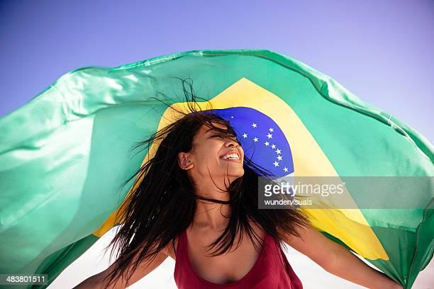 Girl under brazilian flag