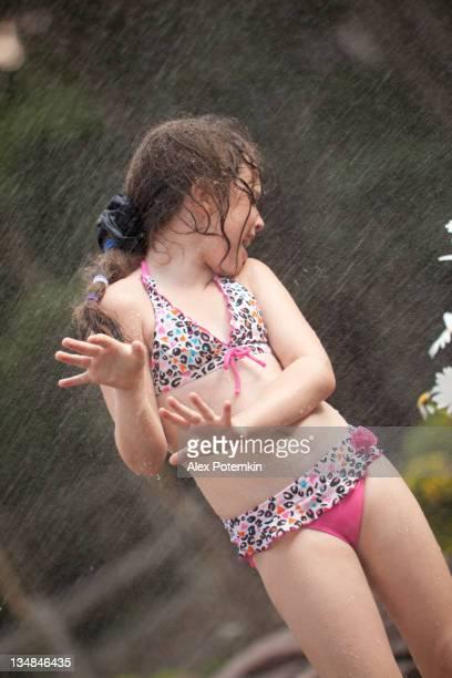Girl under the summer rain