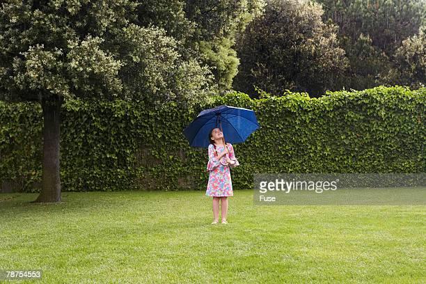 Girl under Umbrella in Rain