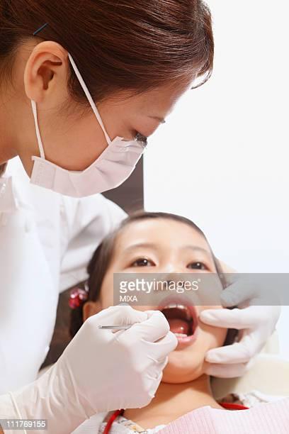 Girl Undergoing Dental Examination