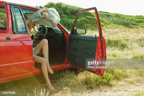 girl undressing in car - girl strips stock pictures, royalty-free photos & images