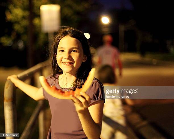 girl unicycling home, eating watermelon - jennifer mellone foto e immagini stock