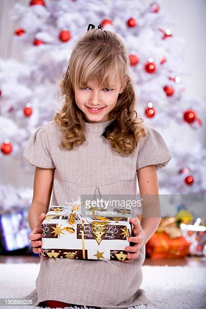 Girl unpacking Christmas gifts