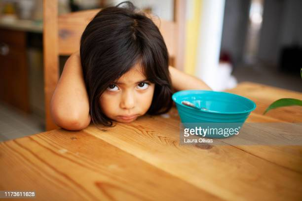 Girl Upset at Kitchen Table