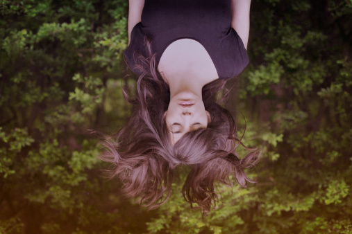 Girl upside down with hair flying and eyes closed - gettyimageskorea