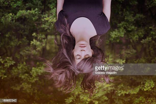 girl upside down with hair flying and eyes closed - upside down stock pictures, royalty-free photos & images