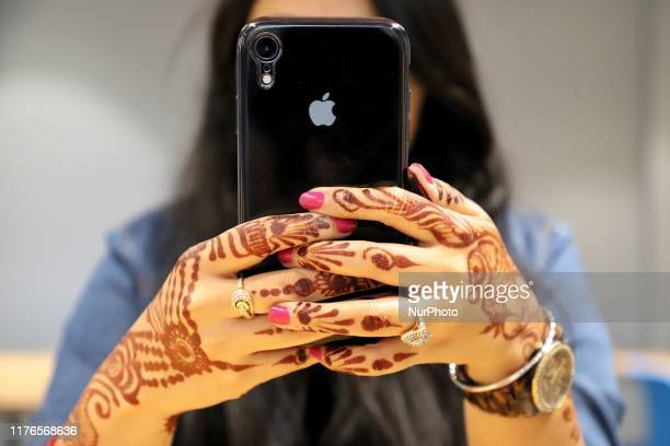 A Girl uses an Apple iPhone inside a Café in New Delhi India on 18 October 2019