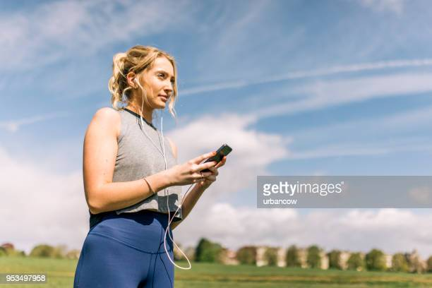 Girl using a phone in the park