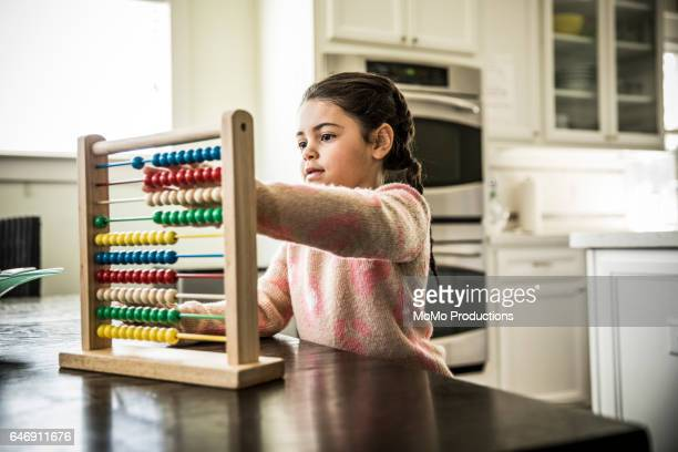 Girl (7 yrs) using abacus