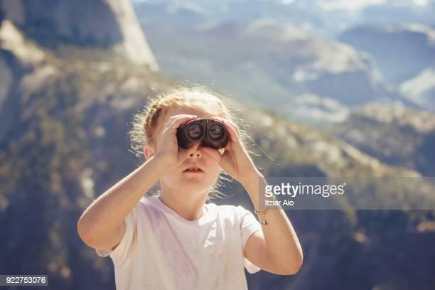 Girl using binoculars at Yosemite National Park