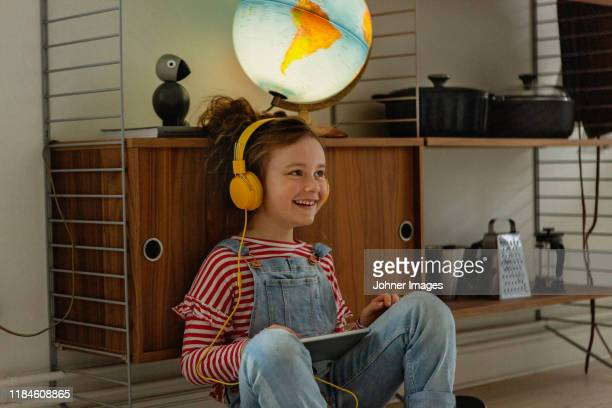 girl using digital tablet - three quarter length stock pictures, royalty-free photos & images
