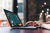 Girl using her laptop for taking part in online poker tournament