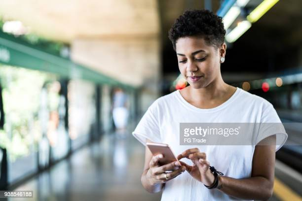 girl using mobile - borough district type stock pictures, royalty-free photos & images