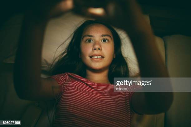 Girl using smart phone in bed
