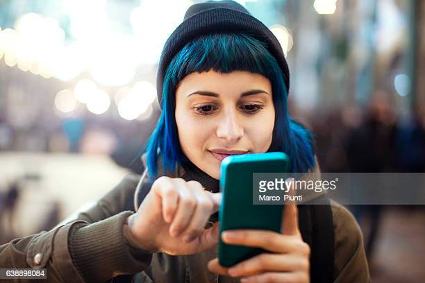 girl using smartphone - blue stock pictures, royalty-free photos & images
