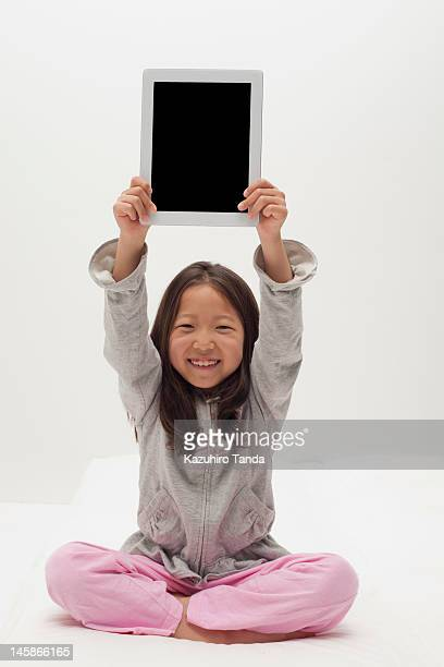 Girl using tablet computer