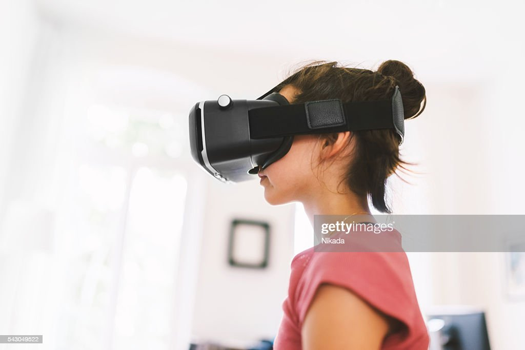 Girl Using Virtual Reality Glasses : Stock Photo