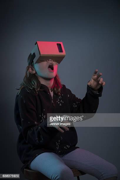 Girl using virtual reality headset.