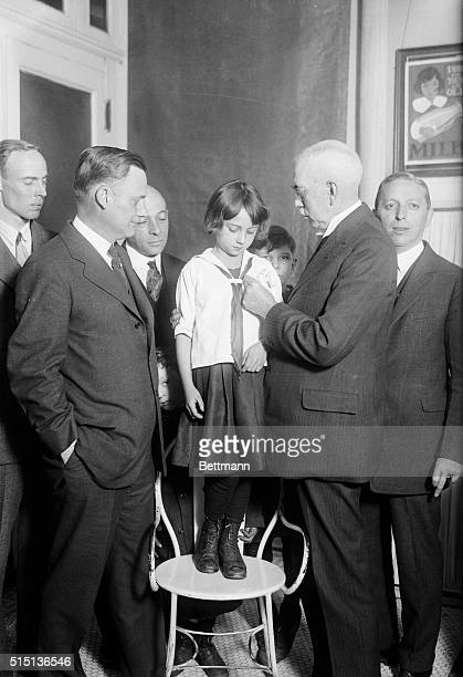 Girl vaccinated against diphtheria New YorkPhoto shows Dr Frank J Monaghan Commissioner of Health of New York City as he pins a vaccination button on...