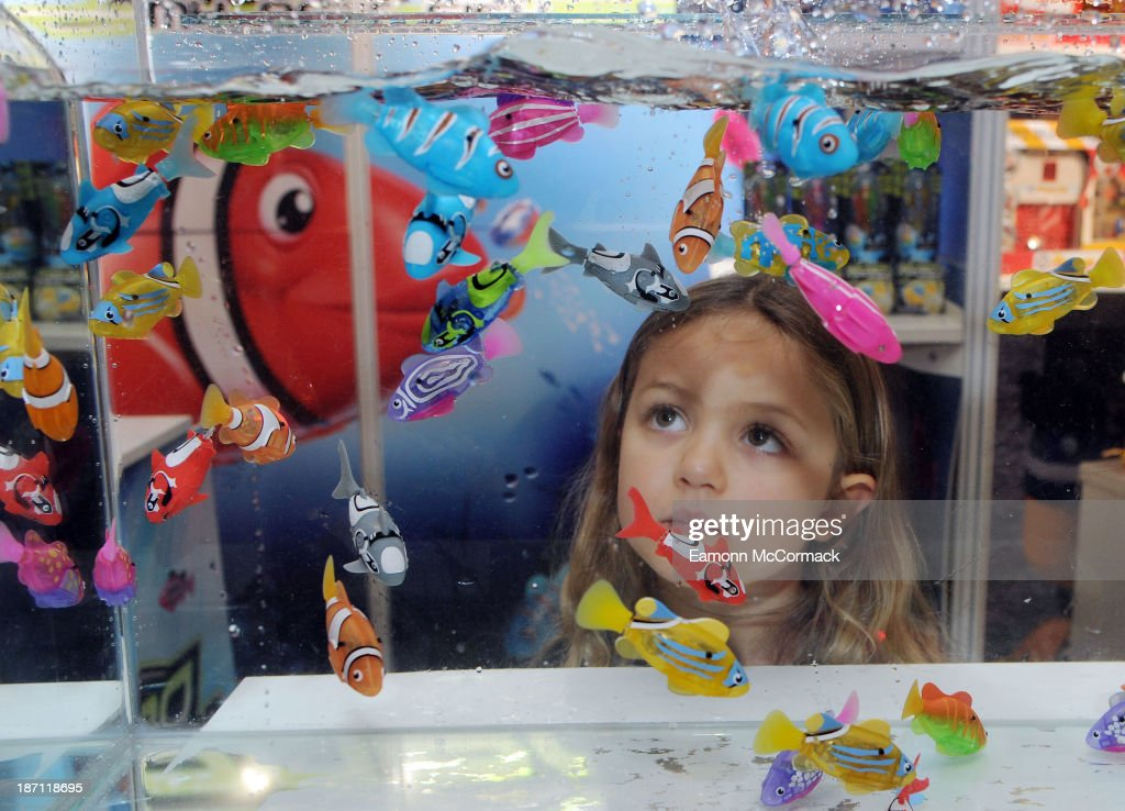 A girl views the Robo Fishbowl at the Dream Toys 2013 press day at St Mary's on November 6, 2013 in London, England.