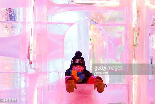 A girl visiting Fantasy Ice World on January 23 2014 in Taipei Taiwan Ice sculptors from the famous Harbin Ice Festival create the 7 wonders of the...
