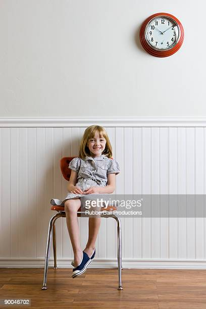 girl waiting against a wall