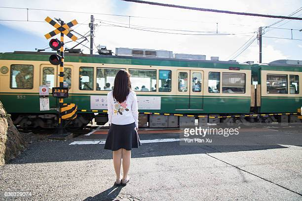 Girl Waiting and Looking at Train Passing