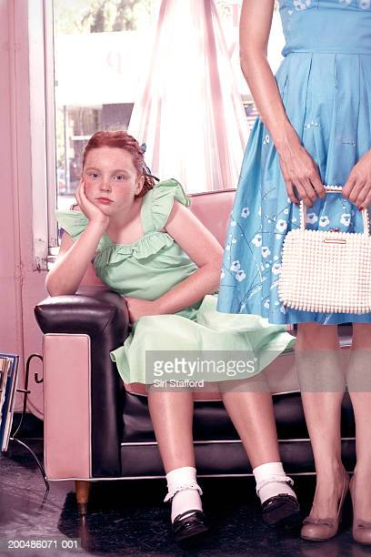 Girl (10-12) waiting in beauty salon
