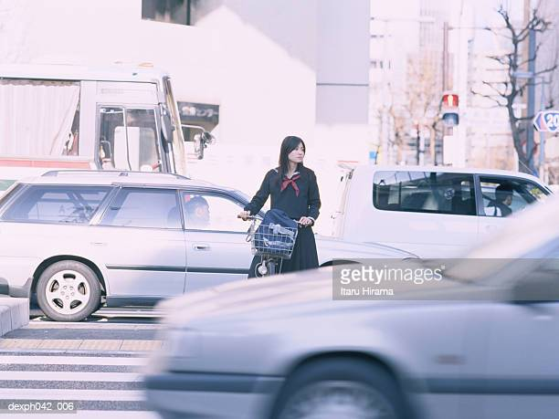 Girl waiting to cross the road