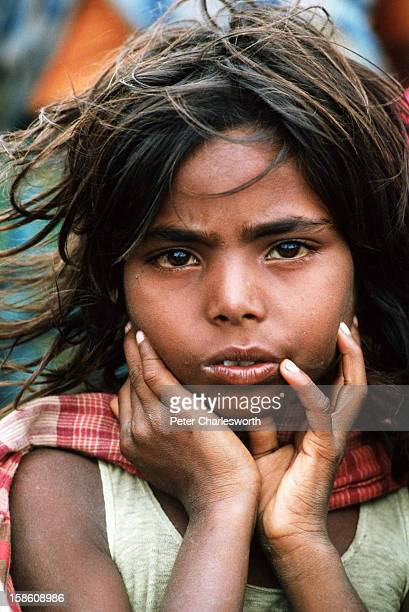A girl waits to be evacuated from one of the lowlying islands off Cox's Bazaar after the biggest cyclone in recent decades completely laid waste to...