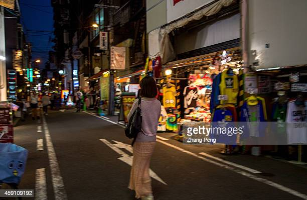 A girl walk on the street after work at night Amerikamura near Shinsaibashi in the Minami district of Osaka is a vibrant place surrounded by outlets...