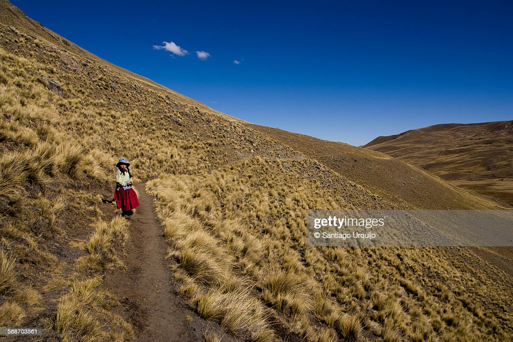 Girl walking alone in the mountains : Stock Photo