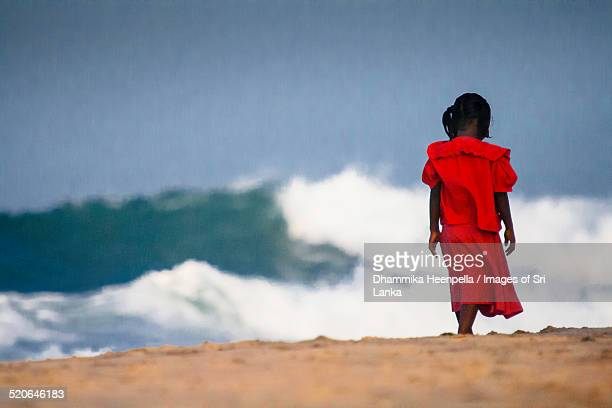 girl walking along the beach - abused child stock photos and pictures