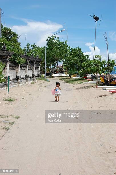 A girl walking along the Sanur Beach