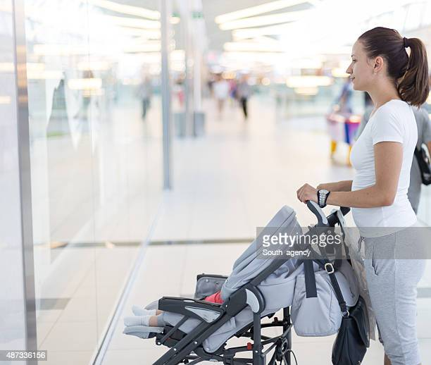 girl walking baby in baby carriage