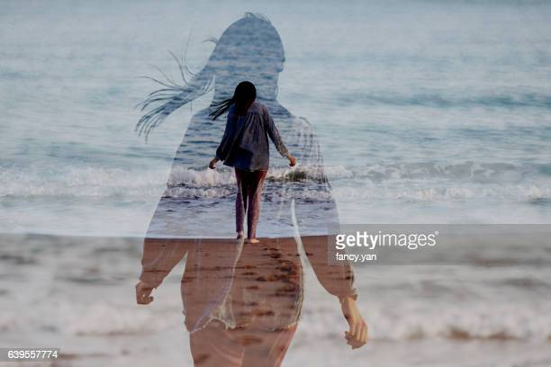 girl walking by seaside - espiritualidad fotografías e imágenes de stock