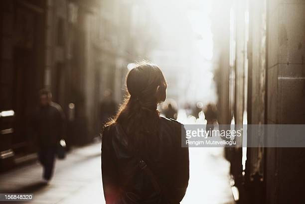 Girl walking down misty street