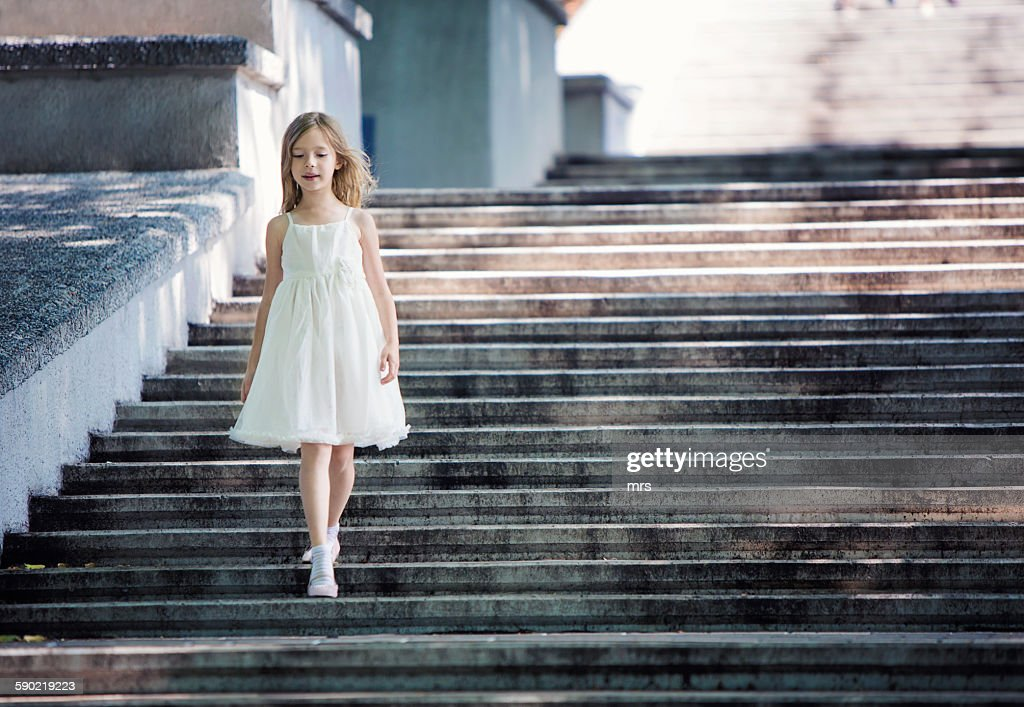 Businesswoman Walking Down Stairs High-Res Stock Photo