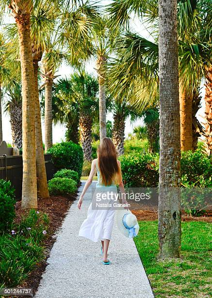 girl walking down the path - hilton head stock pictures, royalty-free photos & images