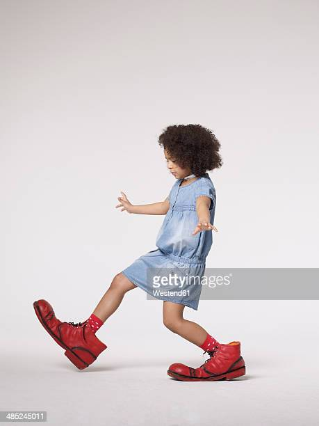 Girl walking in large clown shoes