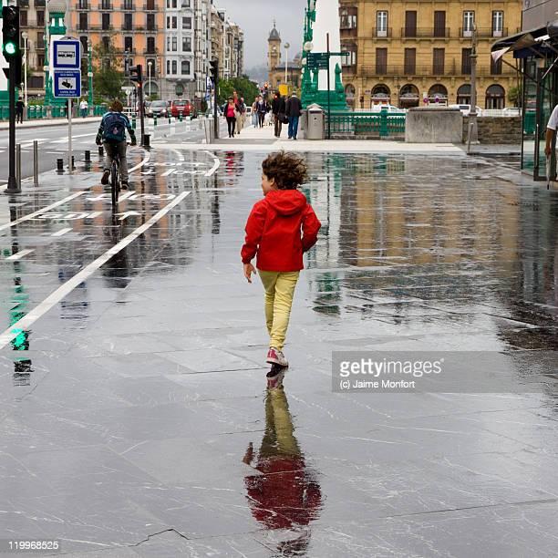 Girl walking in rainy day