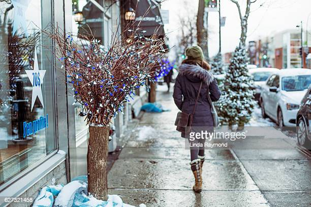 girl walking in the street of Montreal during Christmas time