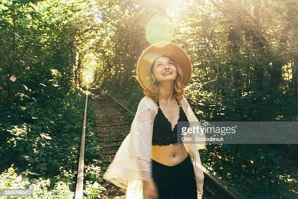 Girl walking in tree tunnel