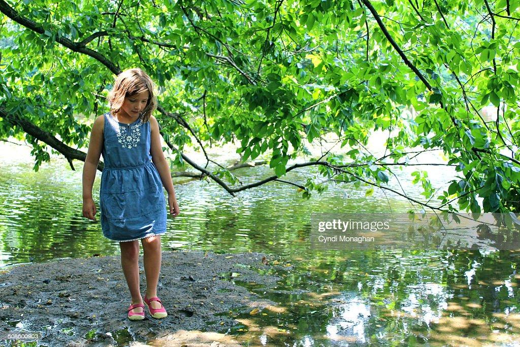 Girl Walking Next to Lake : Stock Photo